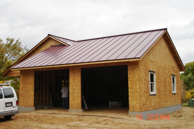sheet Metal Roofing standing seam red maroon colonial house residential wisconsin minnesota iowa illinois north dakota