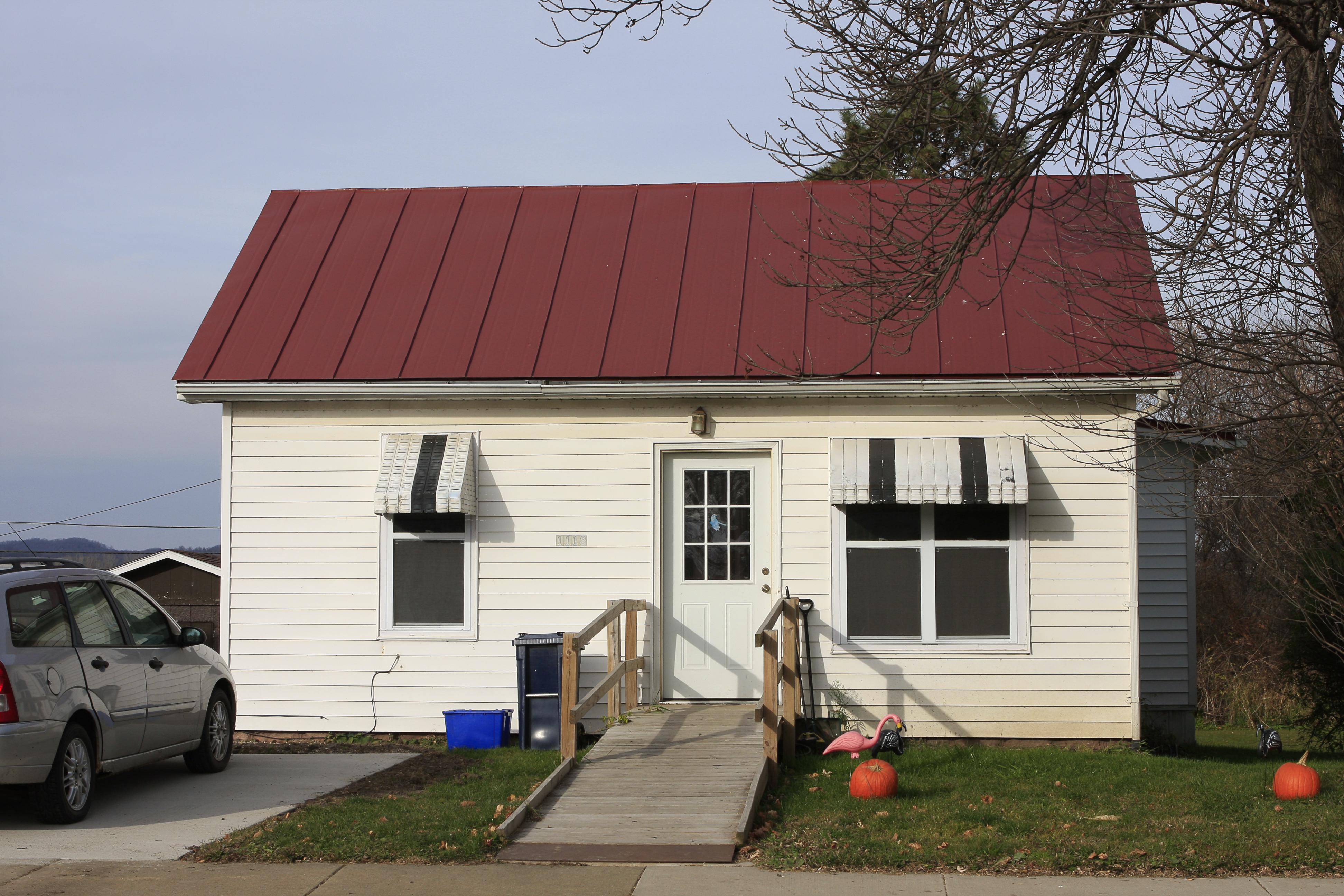 sheet Metal Roofing red colonial residential house wisconsin iowa illinois minnesota north dakota standing seam