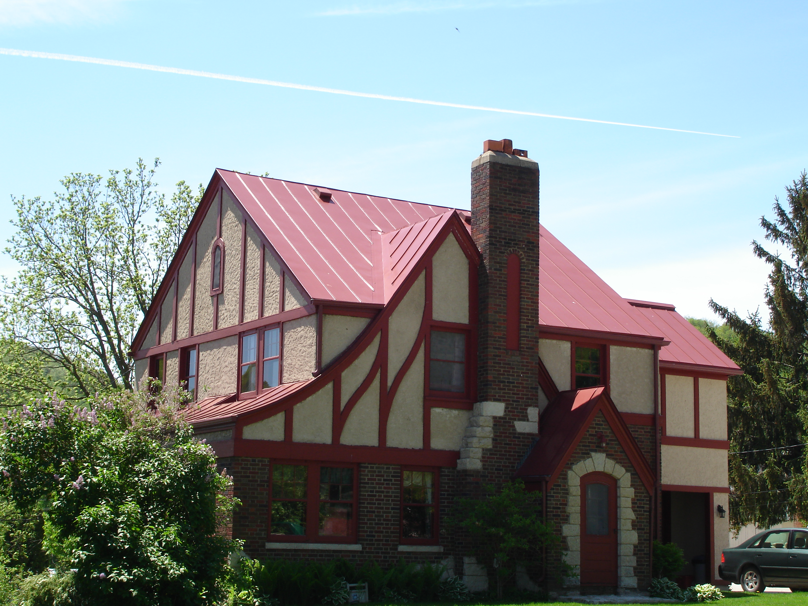 sheet Metal Roofing red colonial residential house wisconsin iowa illinois minnesota north dakota standing seam