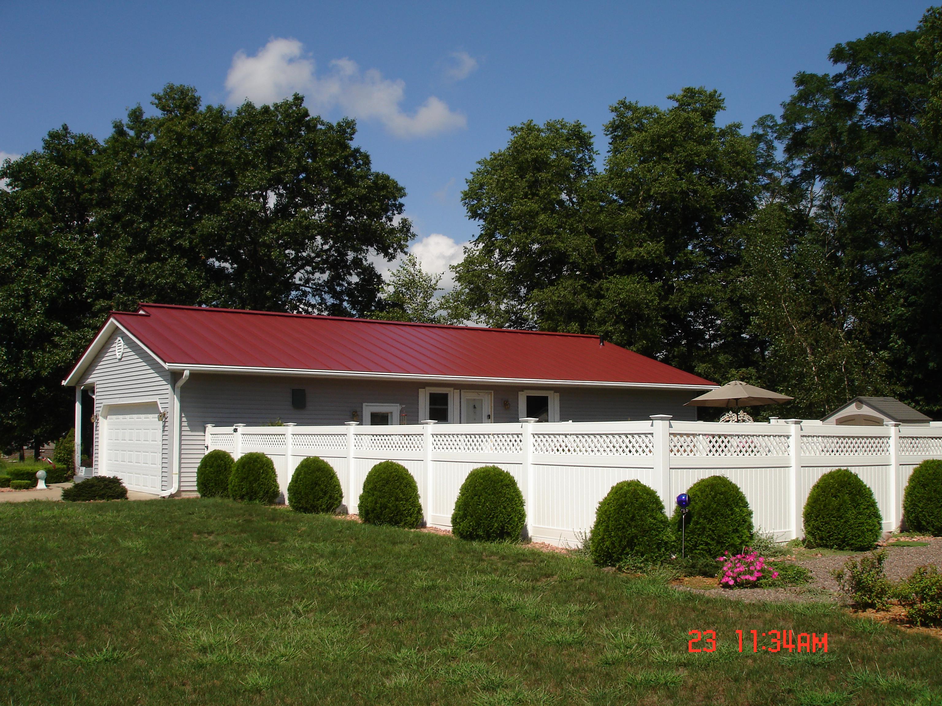 sheet Metal standing seam Roofing red colonial residential house wisconsin iowa illinois minnesota north dakota