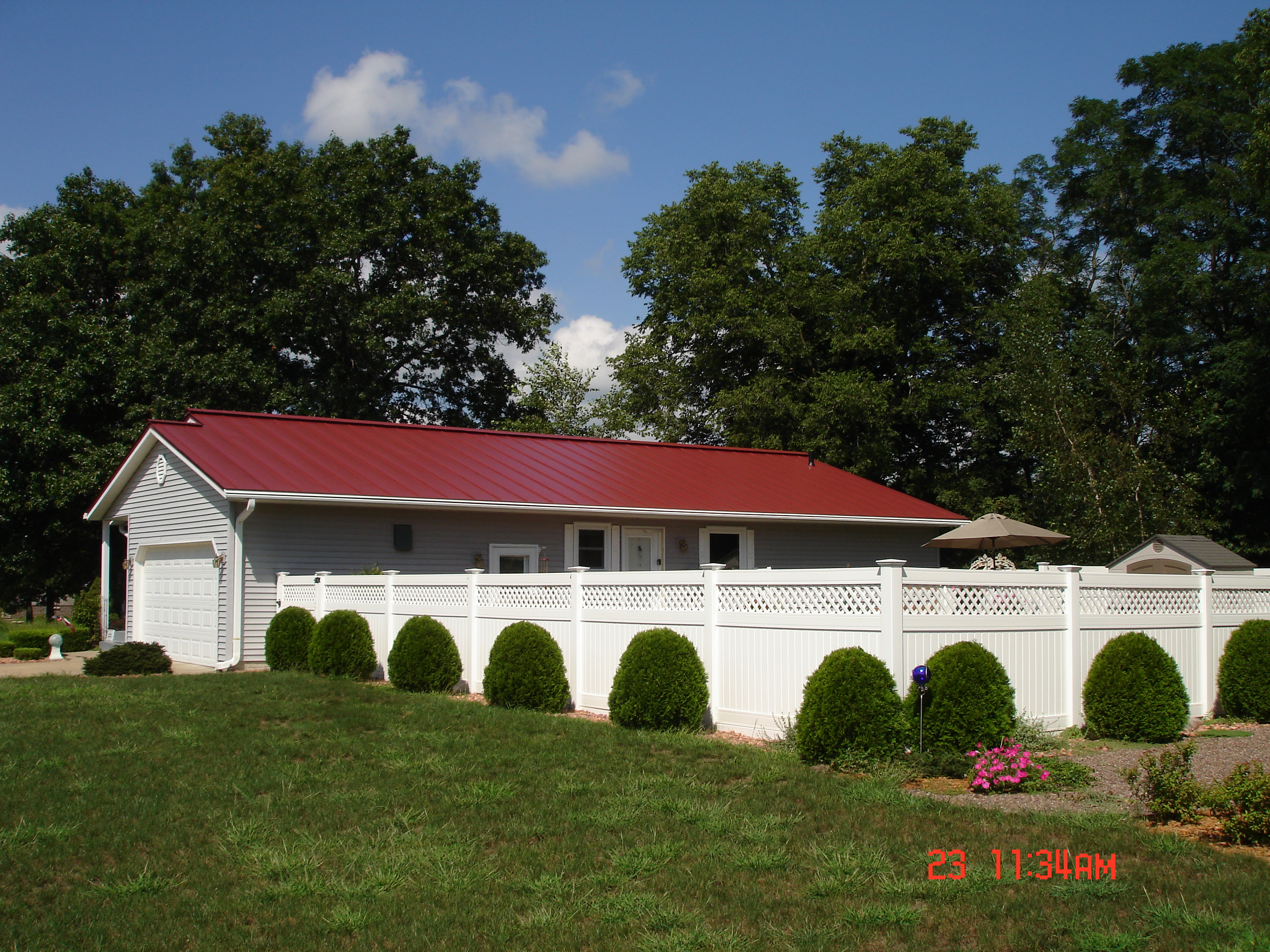 sheet Metal standing seam Roofing red colonial residential house wisconsin iowa illinois minnesota north dakota