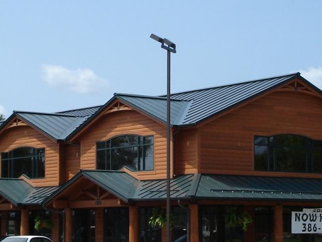 Standing seam sheet metal roofing dark green commercial wisconsin minnesota illinois iowa north dakota snow rail