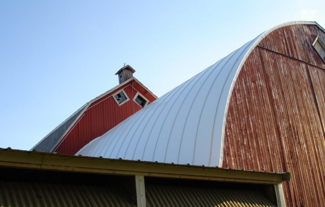 barn standing seam double lock metal roofing gothic hip white