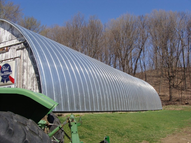 Quonset barn silver salvanized stainding seam metal roof