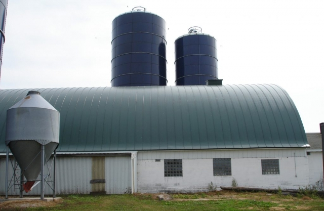 green gothic barn standing seam metal roof