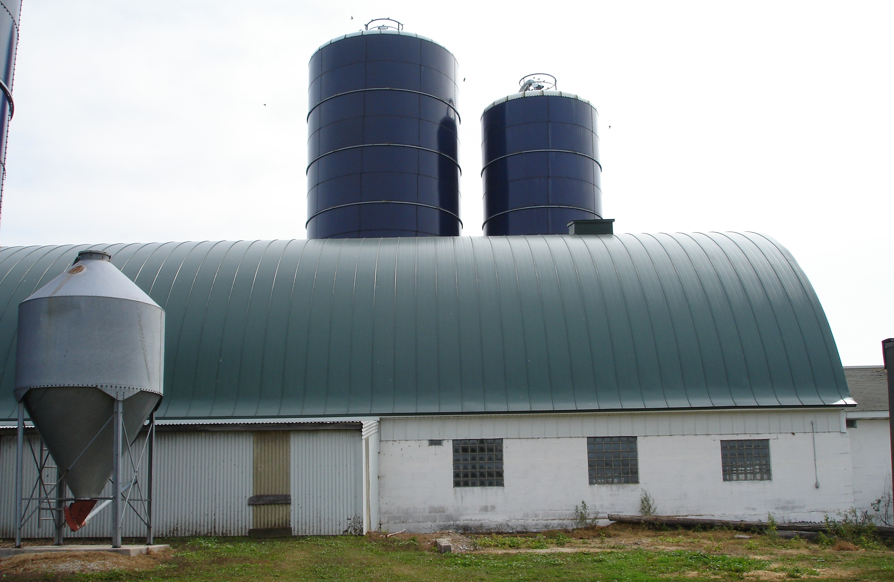 sherwood dark green agricultural gothic barn standing seam sheet metal roofing culpitt wisconsin minnesota iowa illinois north dakota