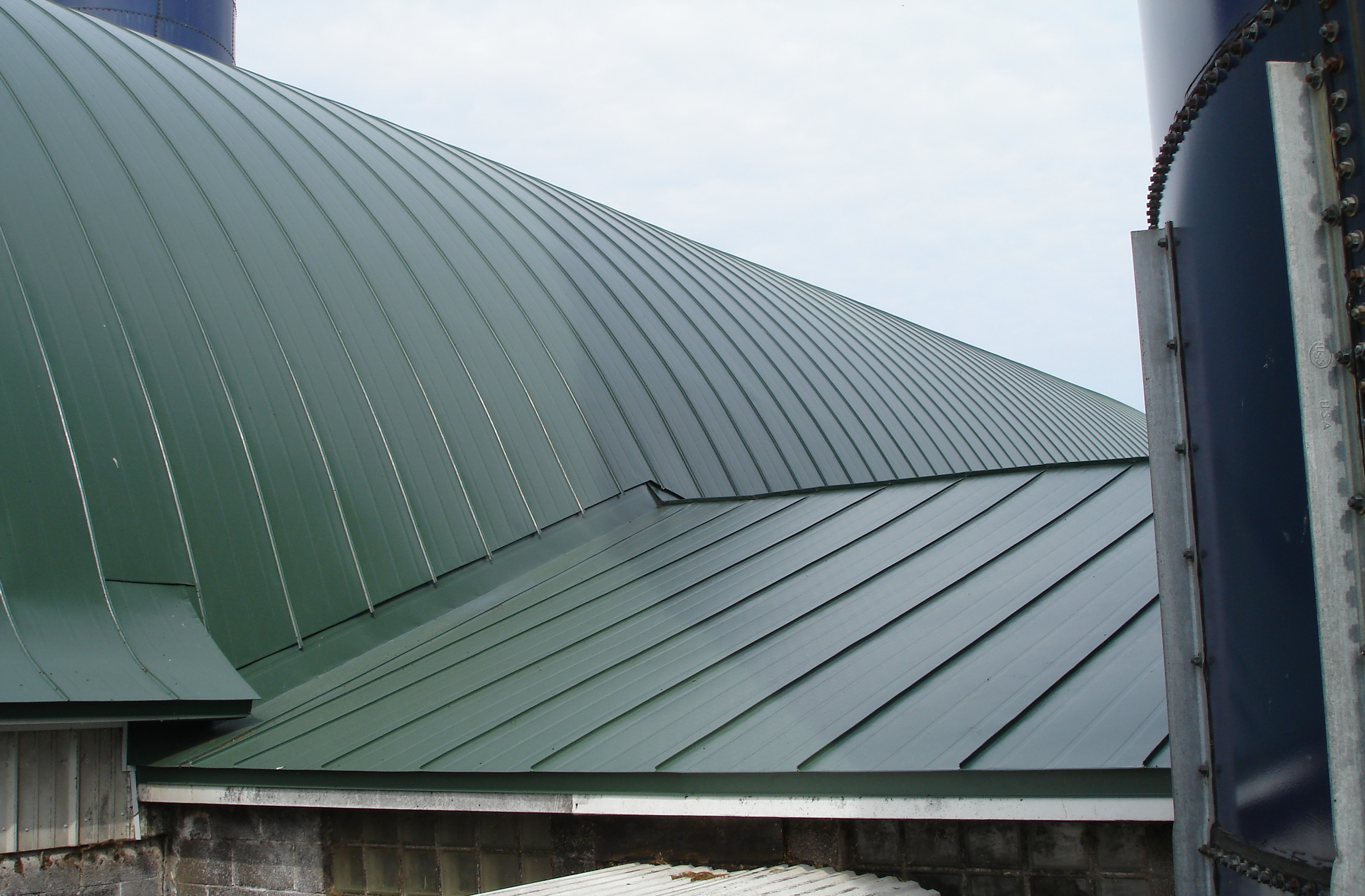 dark sherwood green gothic barn agricultural double lock standing seam sheet metal roofing culpitt wisconsin iowa illinois minnesota north dakota
