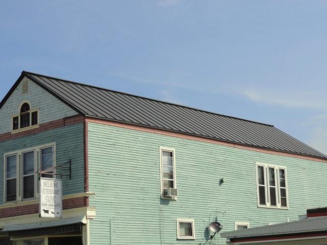 Standing seam sheet metal roofing veterinary clinic grey dark black commercial wisconsin minnesota illinois iowa north dakota