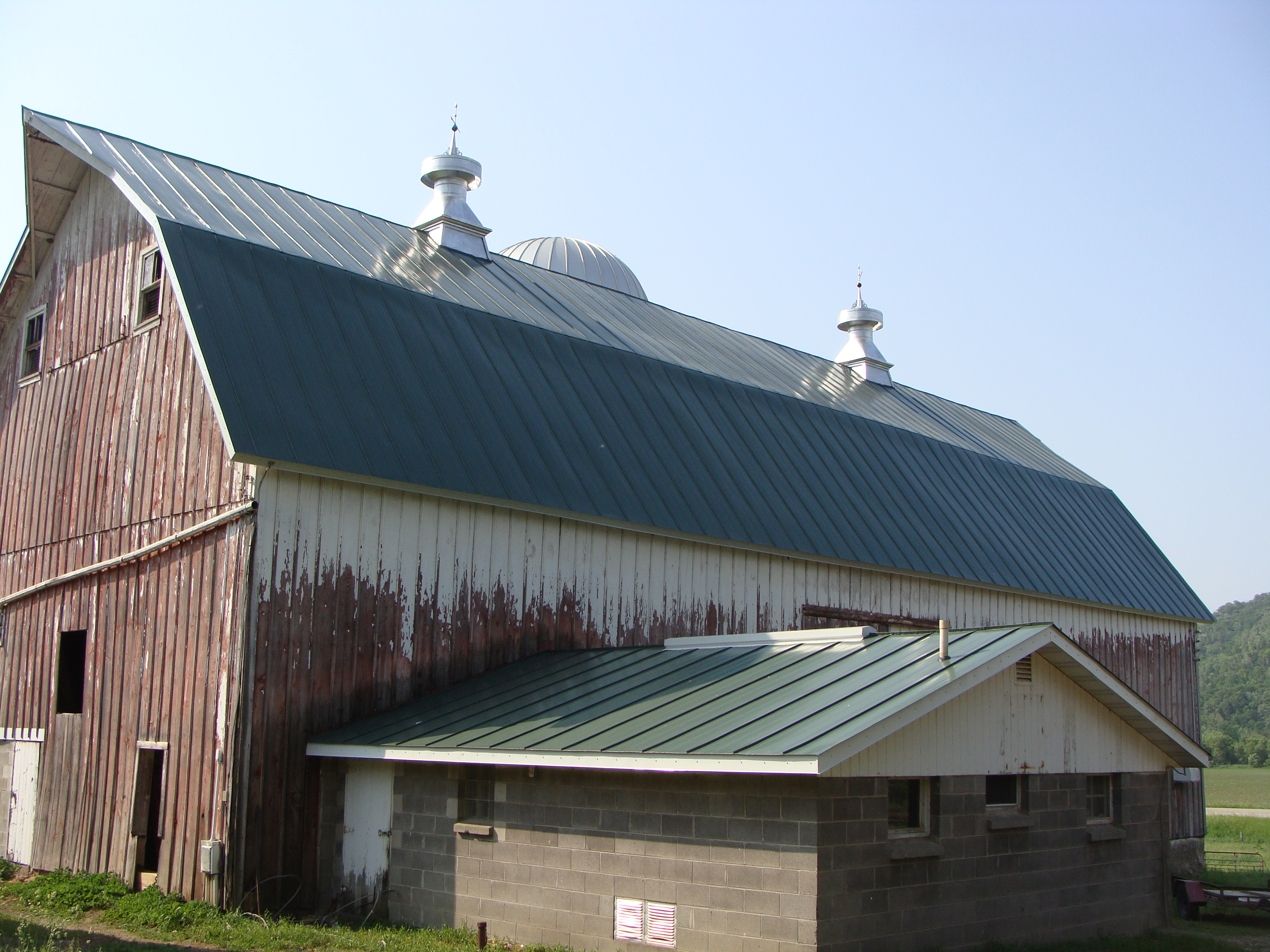 Hip green roof standing seam metal roof