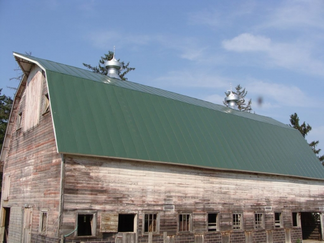 double lock standing seam sheet metal roofing hip barn dark Sherwood green agricultural cupola culpitt wisconsin illinois iowa minnesota north dakota
