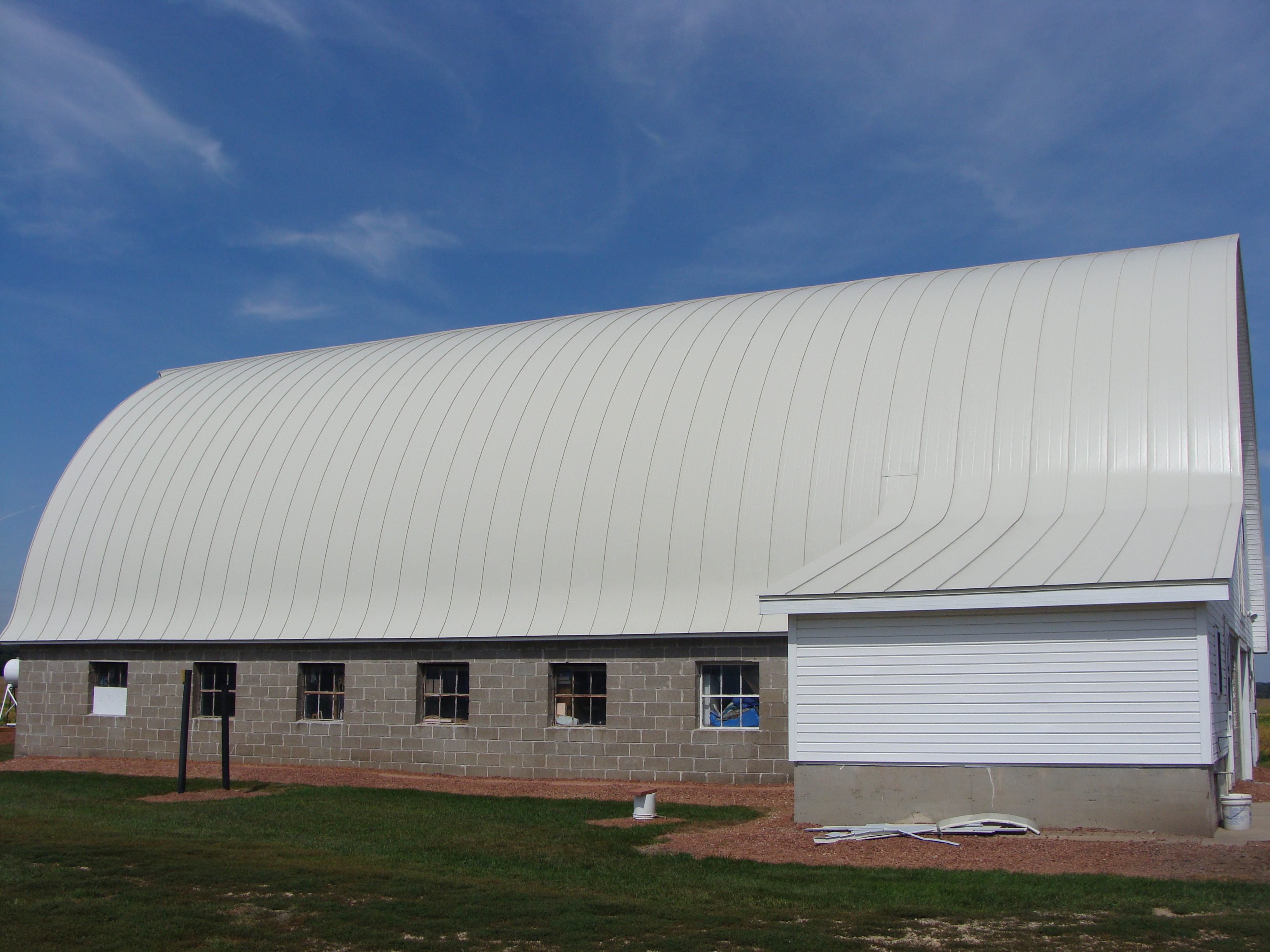double lock standing seam sheet metal roofing bone white gothic agricultural barn wisconsin iowa illinois minnesota north dakota culpitt