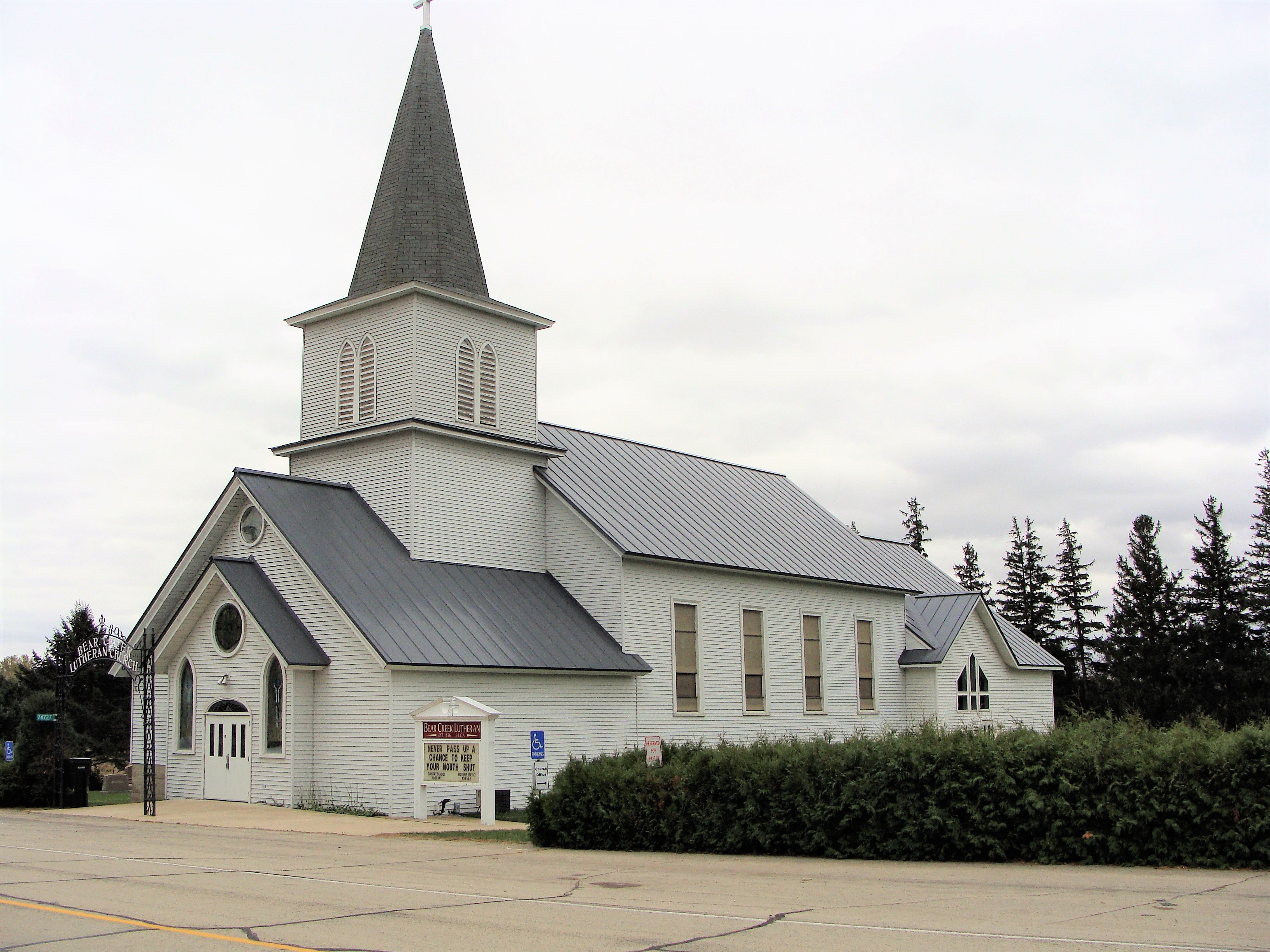 Standing seam sheet metal roofing light grey silver cityscape bear creek lutheran church grand meadow minnesota commercial illinois wisconsin iowa north dakota