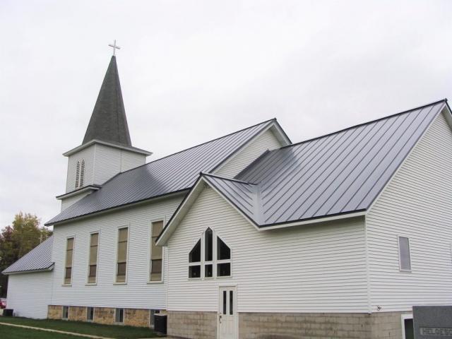 Standing seam sheet metal roofing light grey cityscape silver commercial wisconsin minnesota illinois iowa north dakota bear creek lutheran church grand meadow