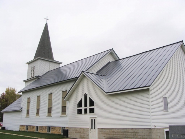 Standing seam sheet metal roofing light grey cityscape silver commercial wisconsin minnesota illinois iowa north dakota bear creek lutheran church grand meadow