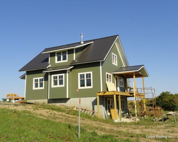standing seam metal roofing dark bronze sheet grey brown black house residential wisconsin iowa minnesota illinois north dakota