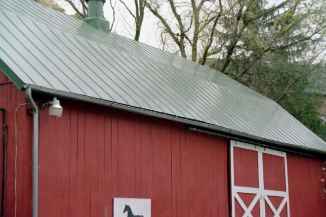 Standing seam metal roofing hip barn hartford green
