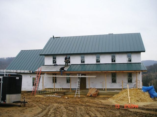 sheet metal standing seam metal roofing hartford green dark house residential wisconsin minnesota iowa illinois north dakota