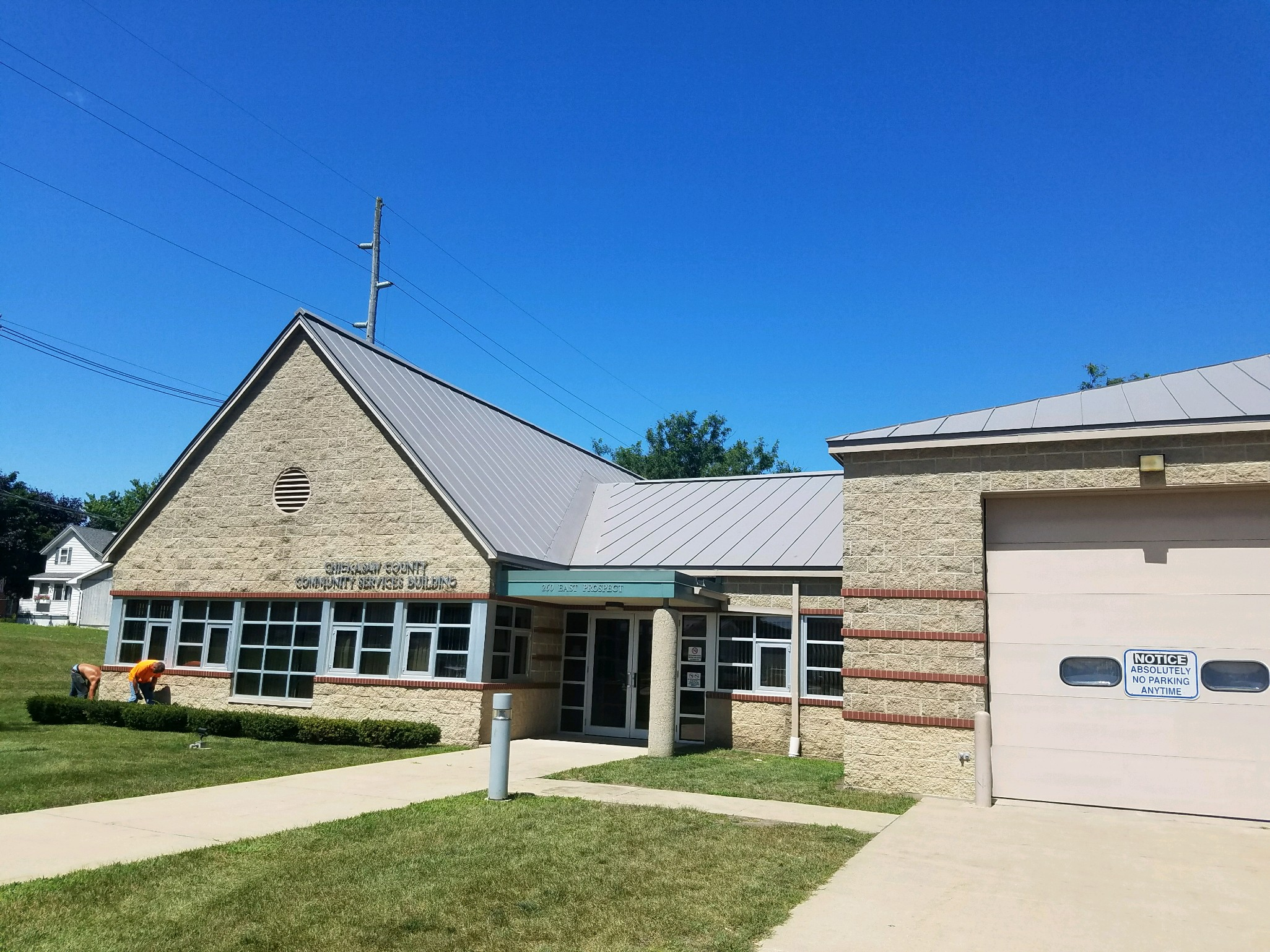 standing seam sheet metal roofing commercial light grey silver wisconsin minnesota illinois iowa north dakota chickasaw county community services building