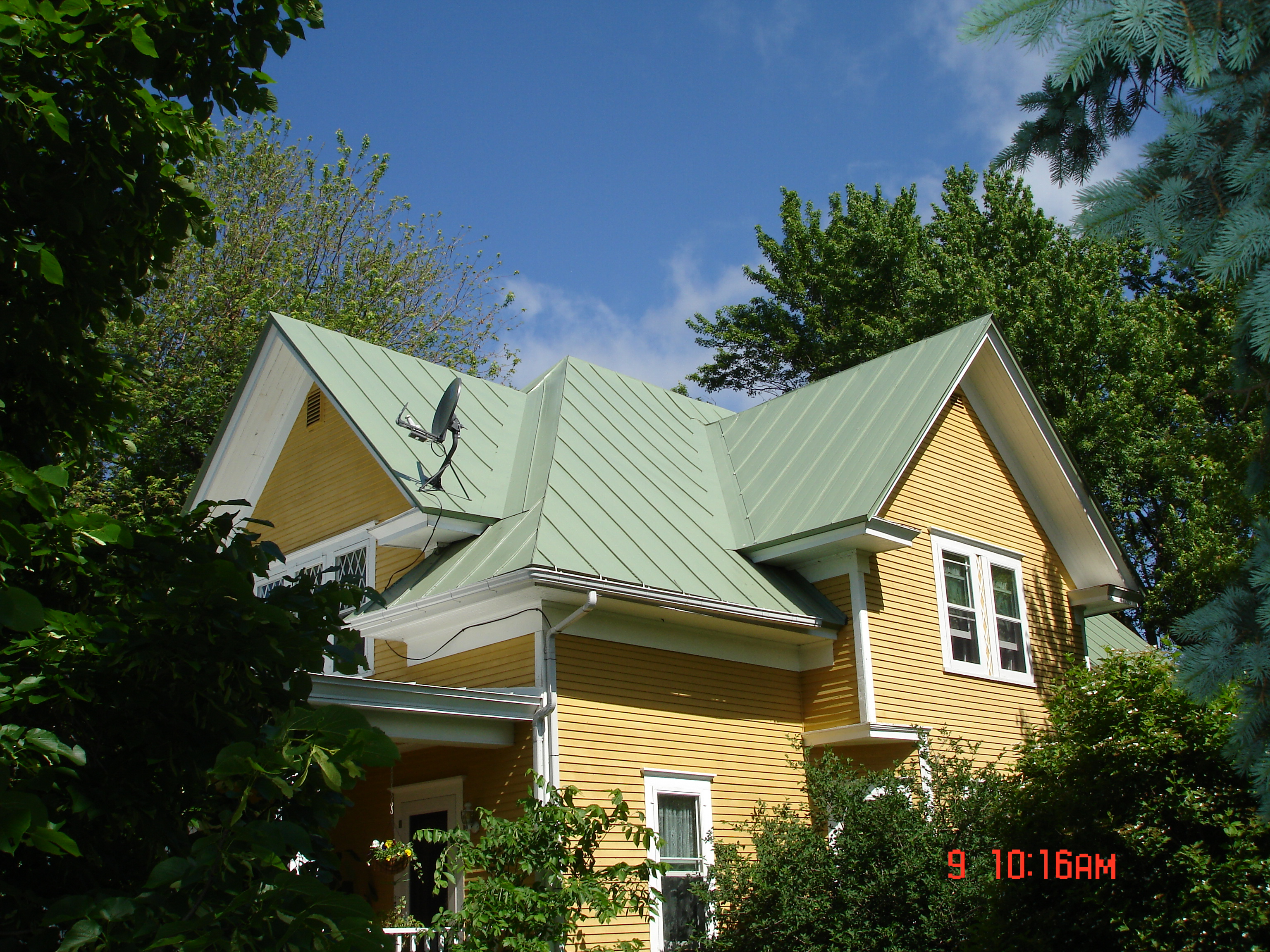 Standing seam sheet metal roofing patina green house residential wisconsin minnesota illinois iowa north dakota