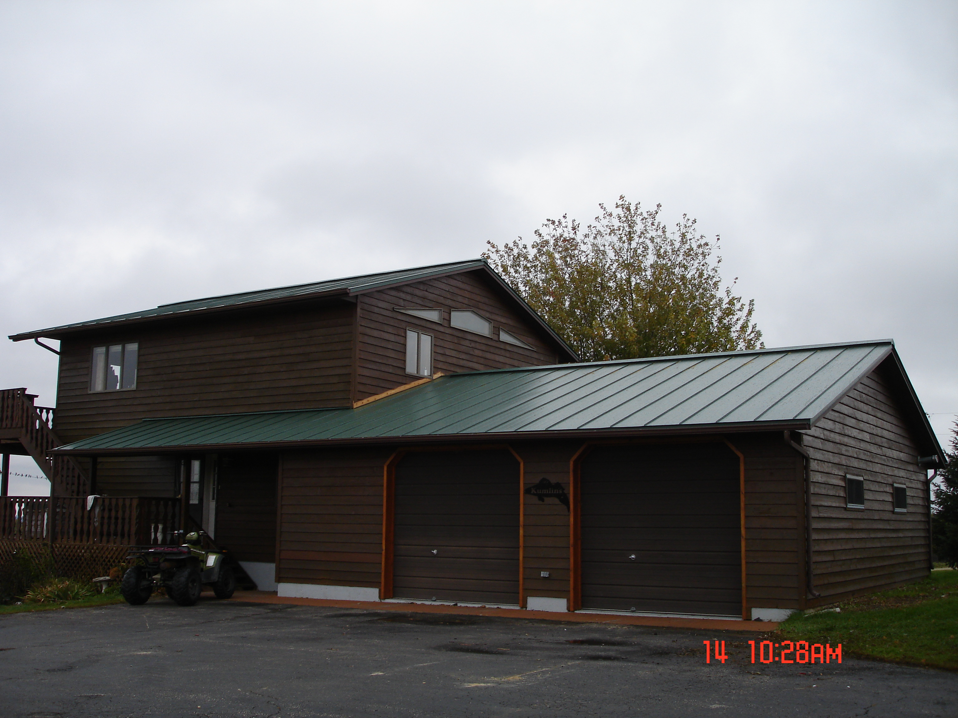 Standing Seam sheet metal roofing dark sherwood green house residential wisconsin iowa minnesota illinois north dakota