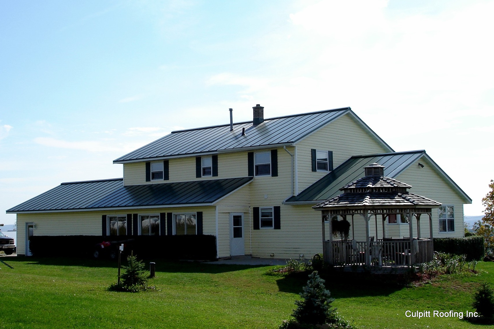 standing seam sheet metal roofing dark sherwood green house residential wisconsin minnesota iowa illinois north dakota