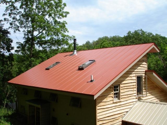 standing seam sheet metal roofing orange terra cotta house residential wisconsin illinois minnesota iowa north dakota