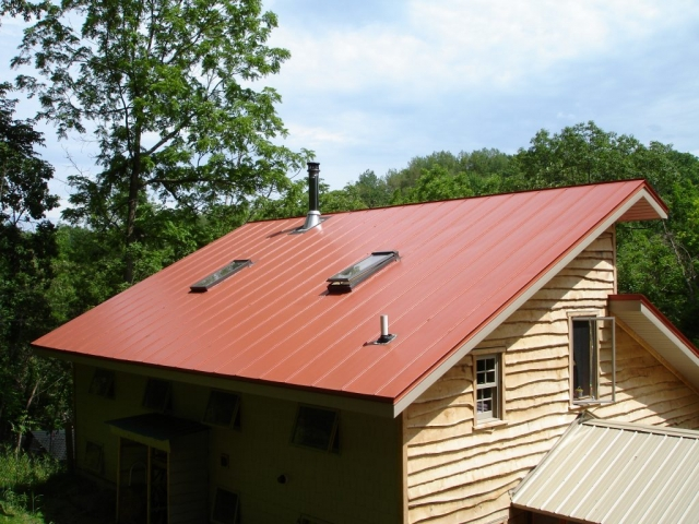 standing seam sheet metal roofing orange terra cotta house residential wisconsin illinois minnesota iowa north dakota