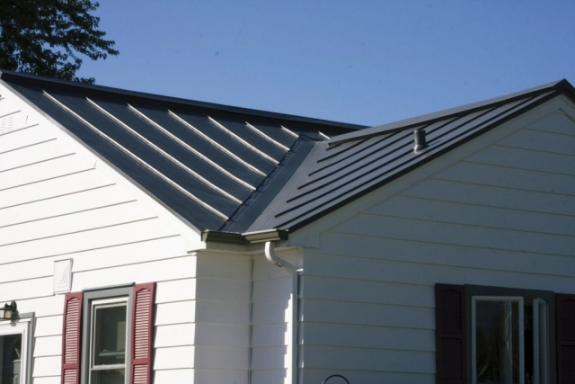 sheet metal standing seam roofing grey charcoal black house residential wisconsin iowa illinois minnesota north dakota