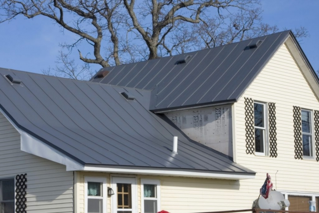 sheet metal roofing standing seam charcoal grey black house residential wisconsin iowa minnesota illinois north dakota