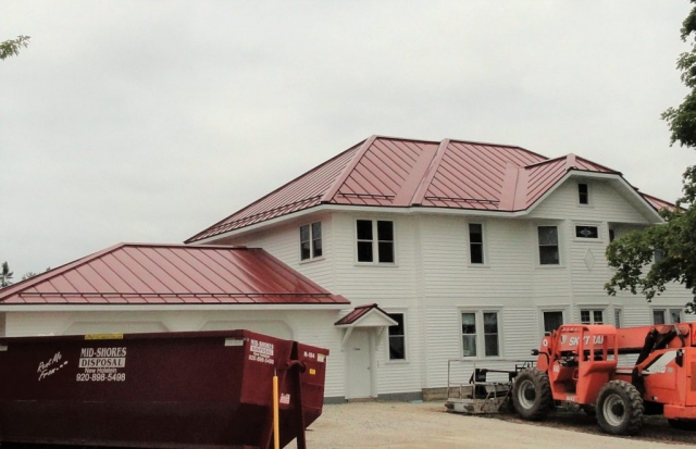 sheet metal roofing red snow rail standing seam residential house wisconsin illinois iowa minnesota north dakota