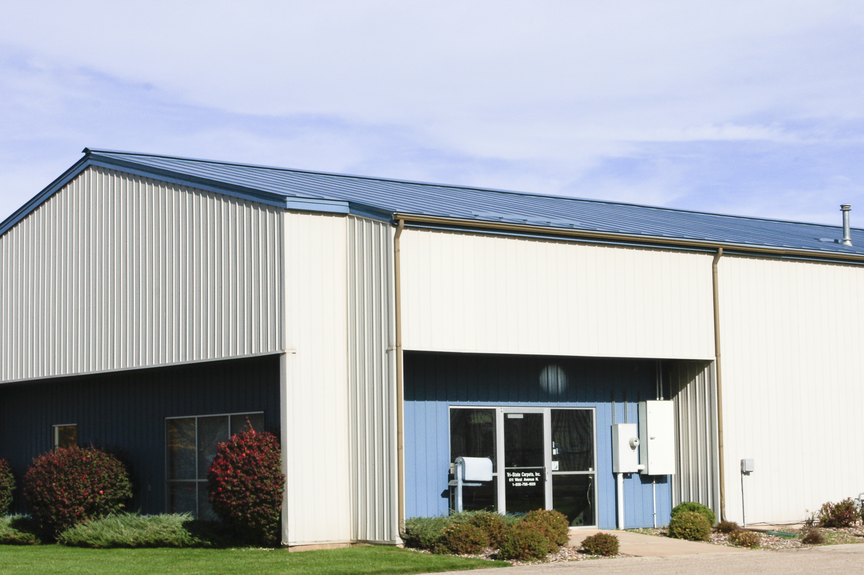 Standing seam sheet metal roofing commercial regal blue wisconsin minnesota iowa illinois north dakota