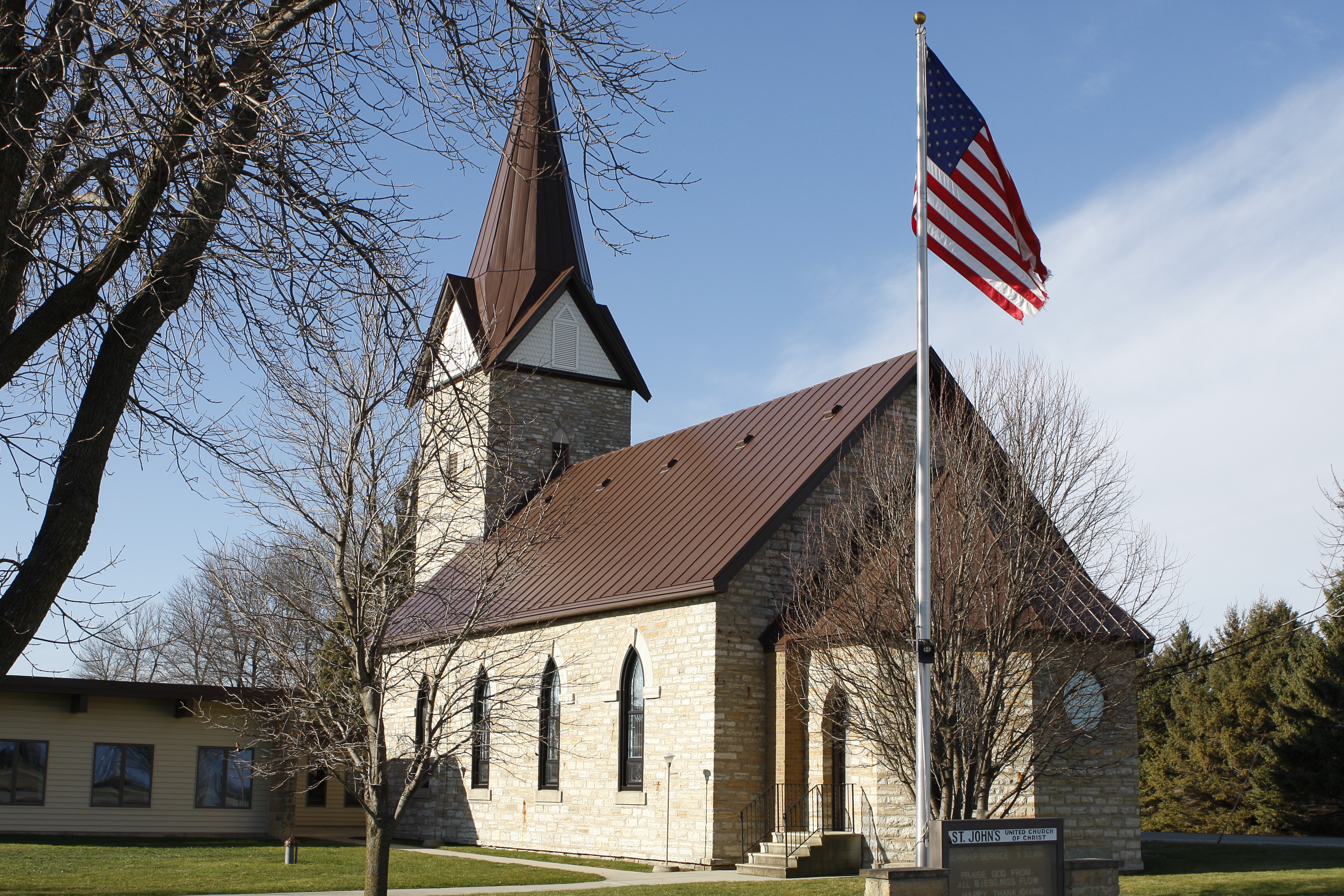 Standing seam sheet metal roofing mansard brown dark church commercial st. john's united christ wisconsin illinois minnesota iowa north dakota