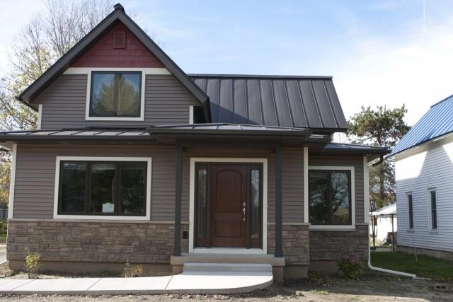 Standing seam sheet metal roofing brown grey black dark bronze residential house wisconsin iowa illinois minnesota north dakota