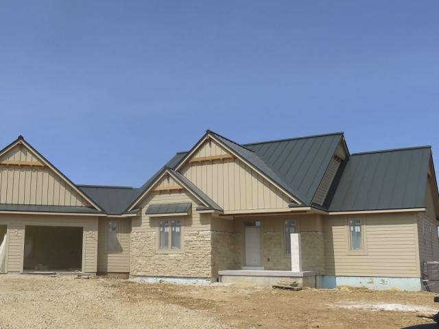 standing seam sheet metal roofing green dark hartford house residential wisconsin iowa minnesota illinois north dakota