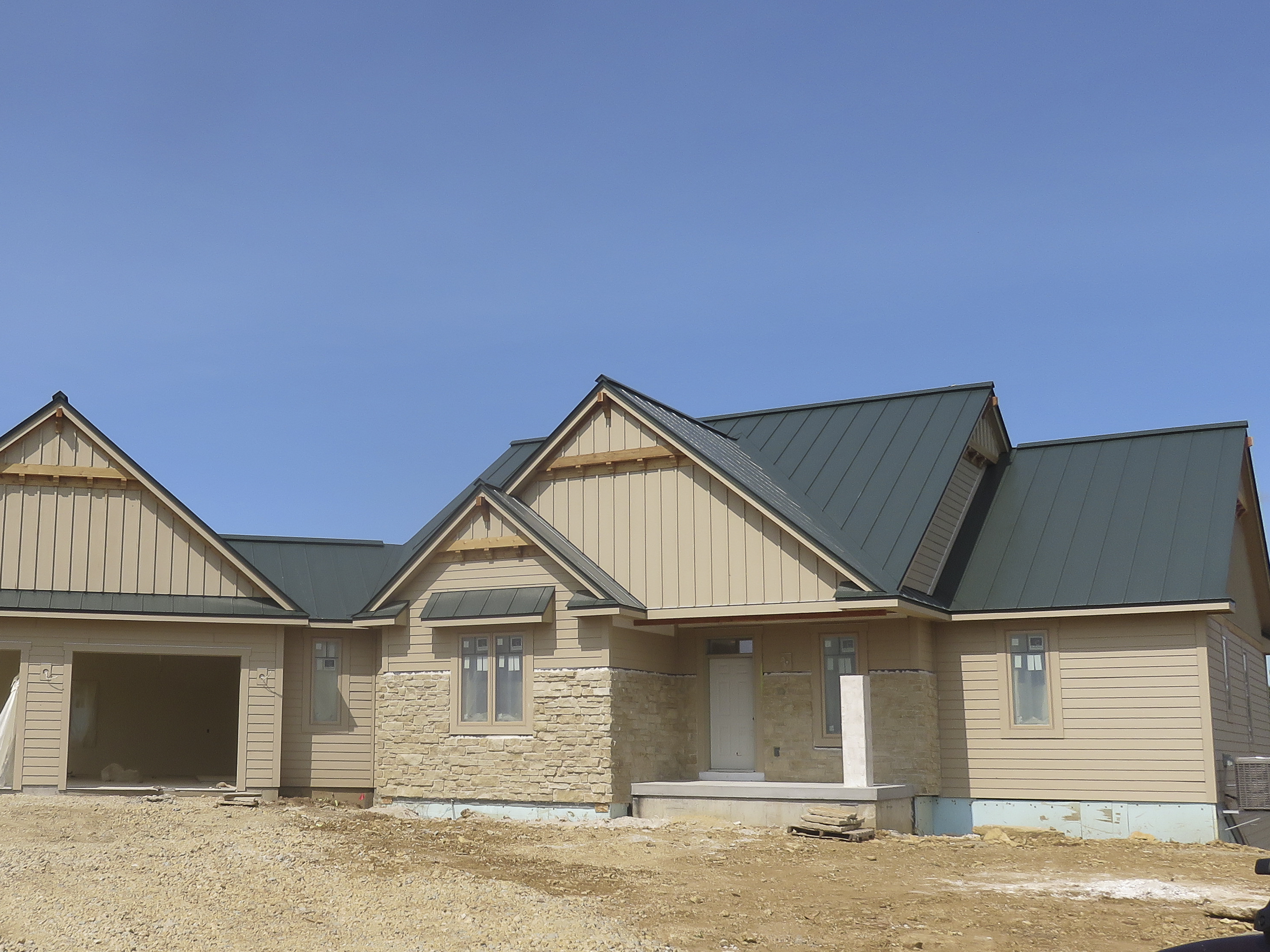 standing seam sheet metal roofing green dark hartford house residential wisconsin iowa minnesota illinois north dakota