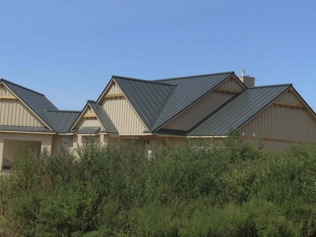 Standing seam sheet metal roofing hartford green dark house residential wisconsin minnesota illinois iowa north dakota
