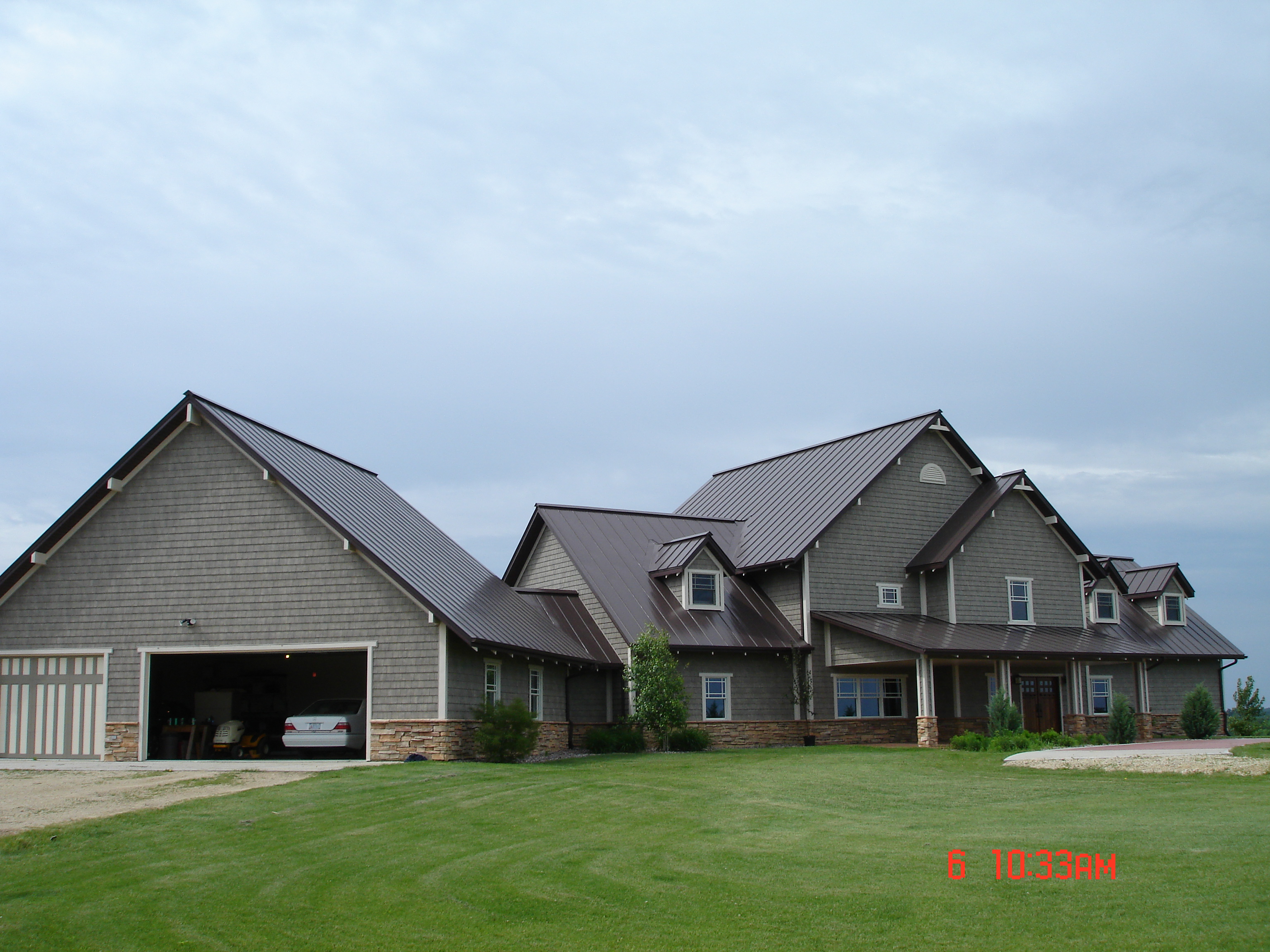 standing seam sheet metal roofing mansard brown house residential wisconsin minnesota iowa illinois north dakota