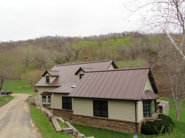 standing seam sheet metal roofing mansard brown dark house residential wisconsin minnesota iowa illinois north dakota
