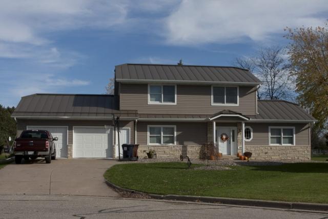 standing seam sheet metal roofing brown snow rail medium bronze house residential wisconsin minnesota iowa illinois north dakota