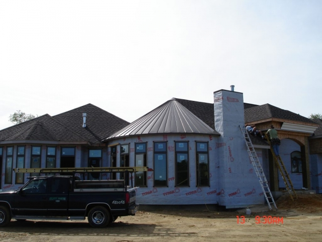Standing seam double lock sheet metal roofing brown medium bronze dark house residential wisconsin minnesota iowa illinois north dakota
