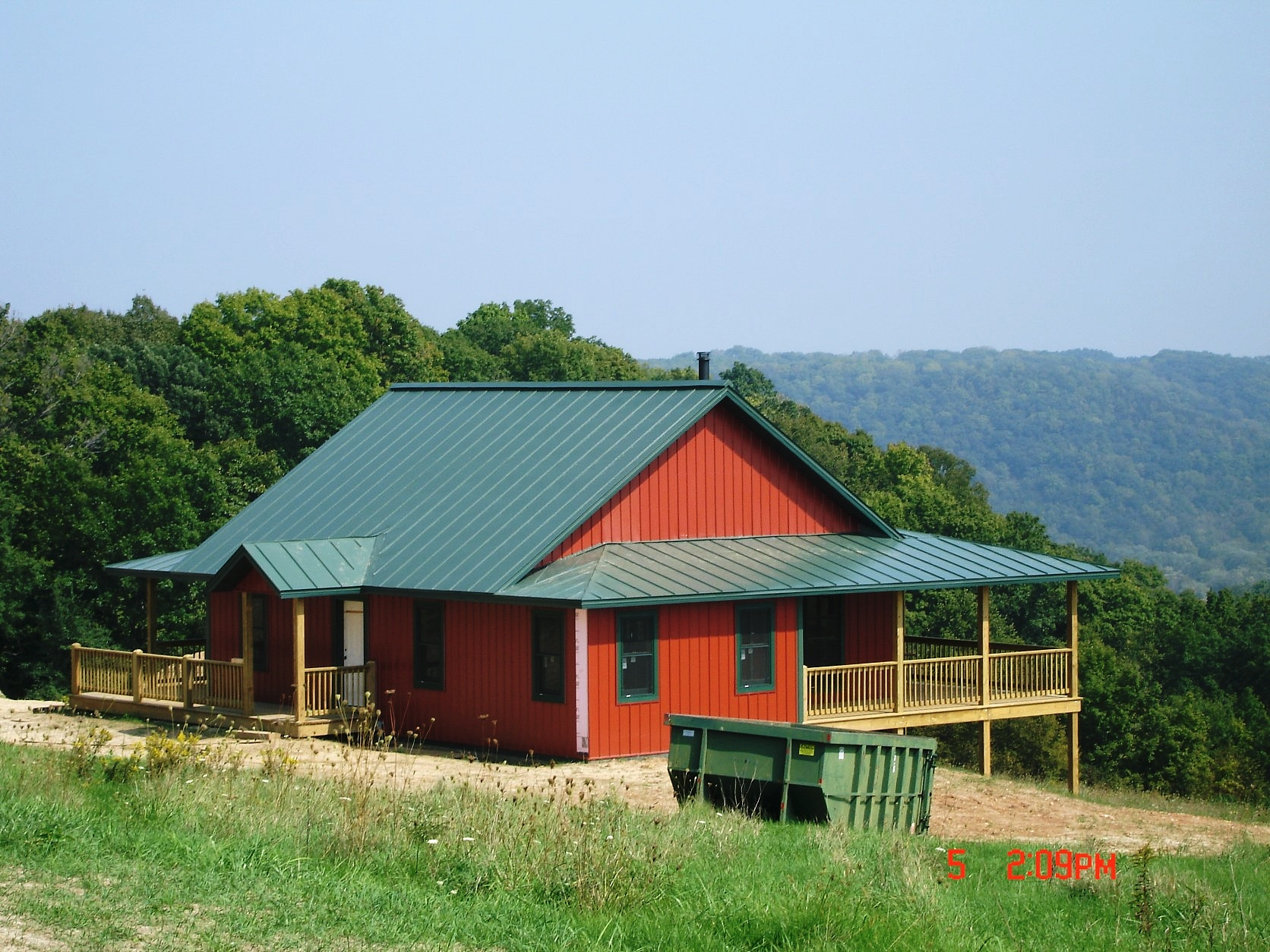 Standing seam sheet metal roofing dark sherwood green house residential wisconsin iowa illinois minnesota north dakota