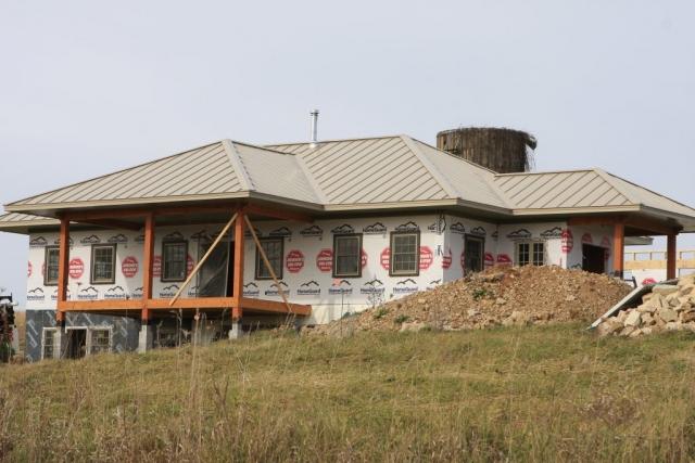standing seam sheet metal roofing sierra tan light brown house residential wisconsin minnesota iowa illinois north dakota