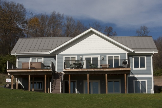 standing seam sheet metal roofing light slate grey house residential snow rail wisconsin minnesota iowa illinois north dakota