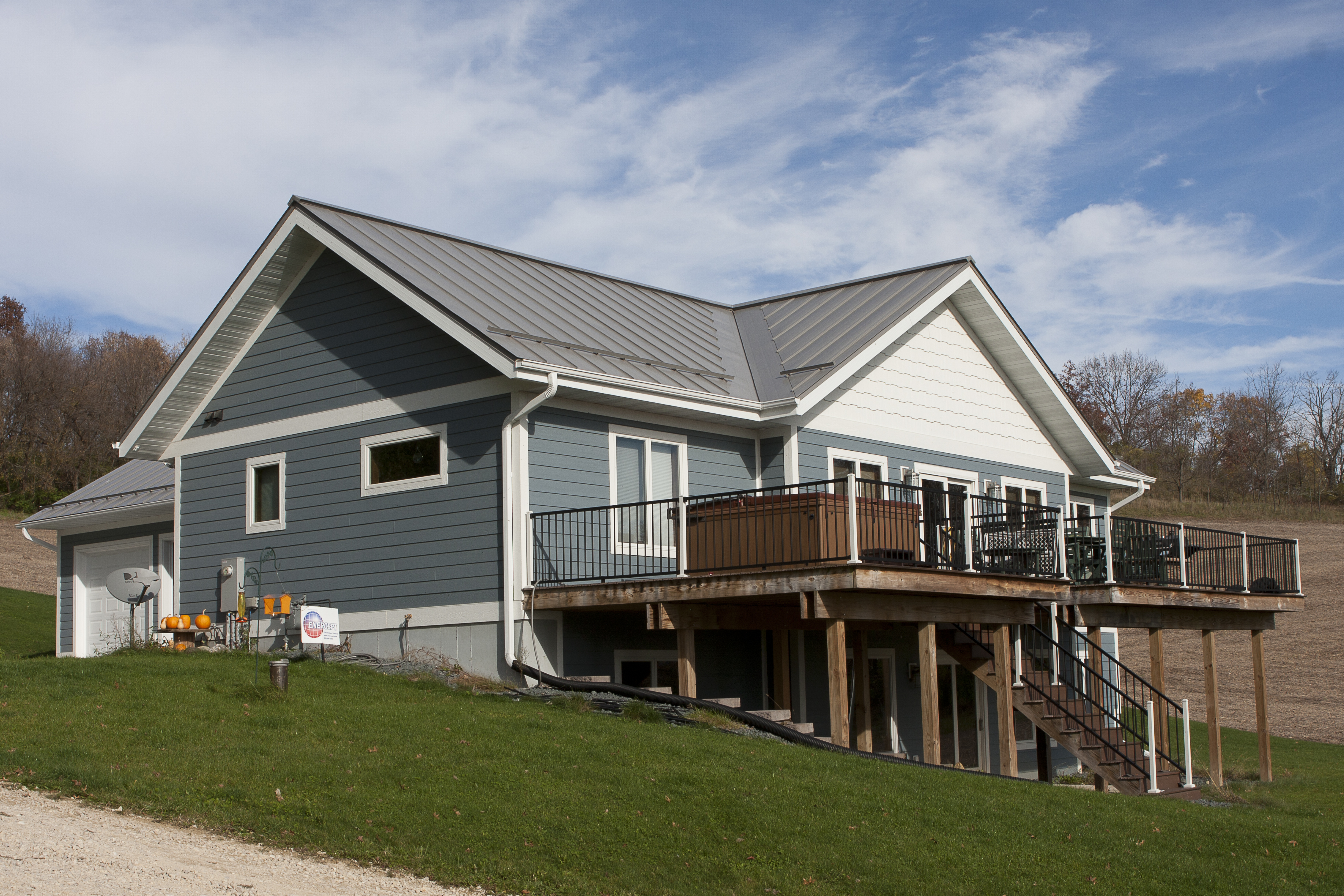 standing seam sheet metal roofing light slate grey snow rail house residential wisconsin minnesota iowa illinois north dakota